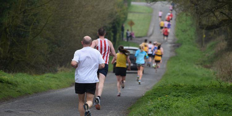 runners downhill