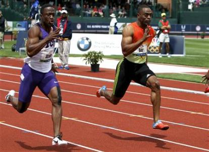 Tyson Gay and Charles Silmon compete in the men's 100 meter semi-final at the US Olympic athletics trials in Eugene